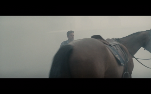 I think we are all as confused as Bruce Wayne is at the sight of this horse butt